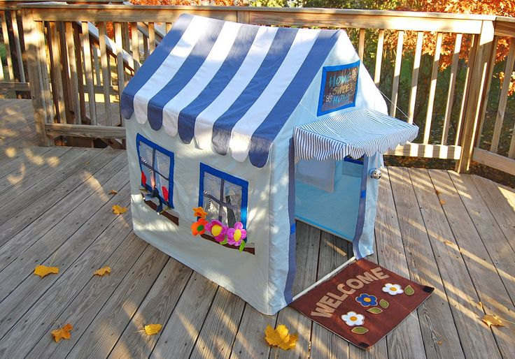"""Amazing PVC pipe house. Man. I can sew, but this blows me away. The fence turns into a welcome mat! The curtains tie back! You can """"plant"""" flowers in the window boxes! There's a mail box! Amazing. From ikat bag"""