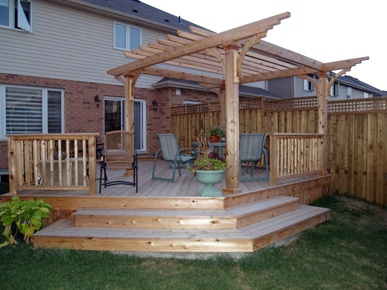 Deck with pergola on an angle with wide steps suitable for extra seating get some outdoor - Suitable materials for decking ...