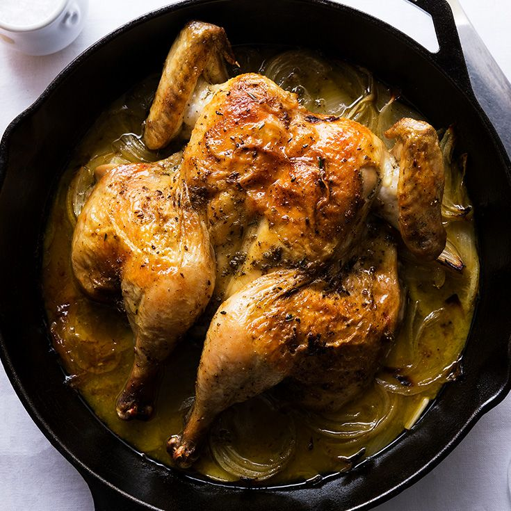 Skillet Roasted Lemon Chicken - This spatchcocked bird is roasted in a thyme and fennel seed oil over a bed of onions and lemon. A splash of wine while cooking turns the juices into a creamy sauce for the ultimate one-pan meal. https://www.tastingtable.com/cook/recipes/skillet-roasted-lemon-chicken-recipe-ina-garten
