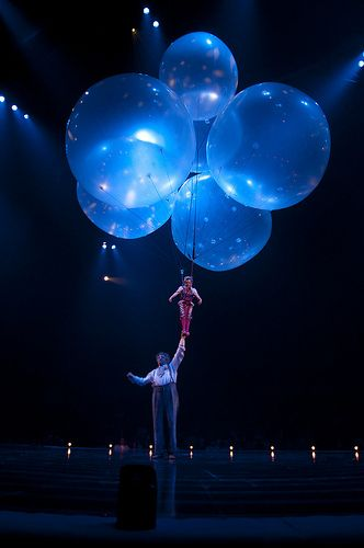 "My favorite moment from ""Corteo"", by Cirque du Soleil. These are clear giant balloons with bursts of light shinning on them."