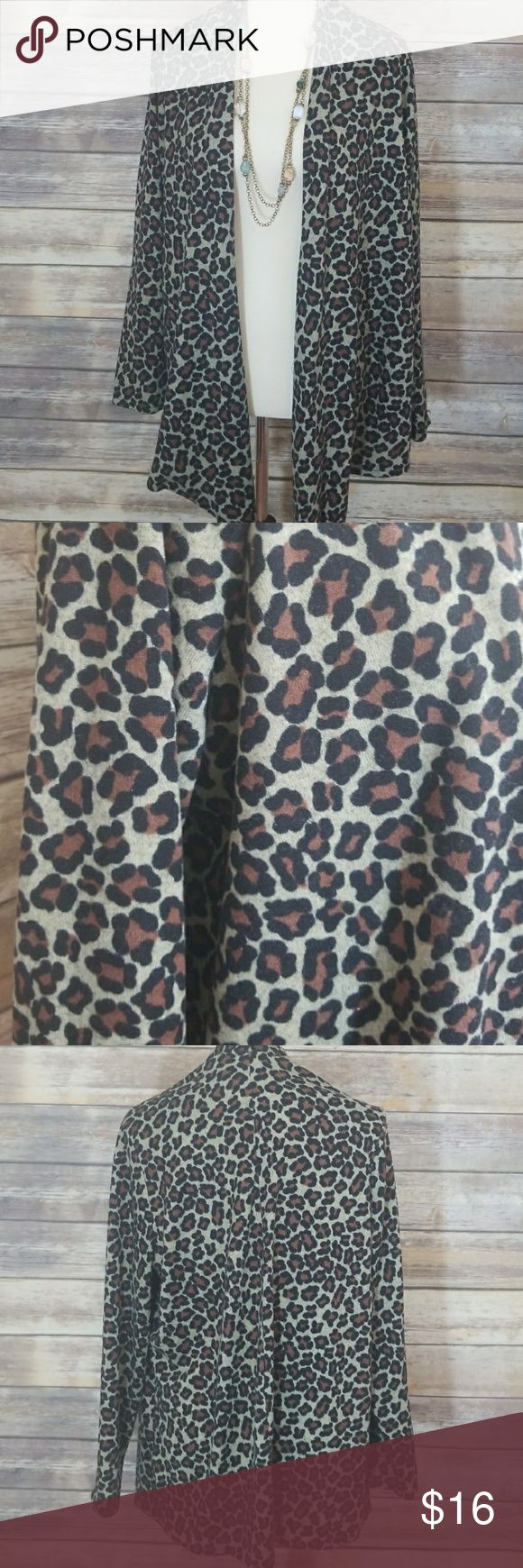 Animal print cardigan. Open front cardigan Open front/ the optional cardigan. Animal print. Very comfortable. Hand wash cold. Earth tone colors. Size XL fits more like large. Slinky Brand Sweaters Cardigans