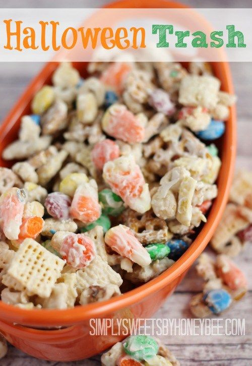 Satisfy a junk food craving with this recipe for Halloween Trash combining cereal, pretzels, peanuts, M&M's, candy corn and almond bark.