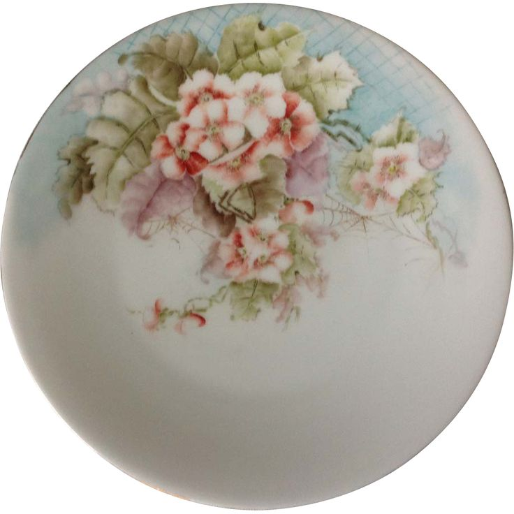 This hand painted TV France floral plate features detailed red and white five petaled blossoms clustered on a spreading branch that covers nearly half