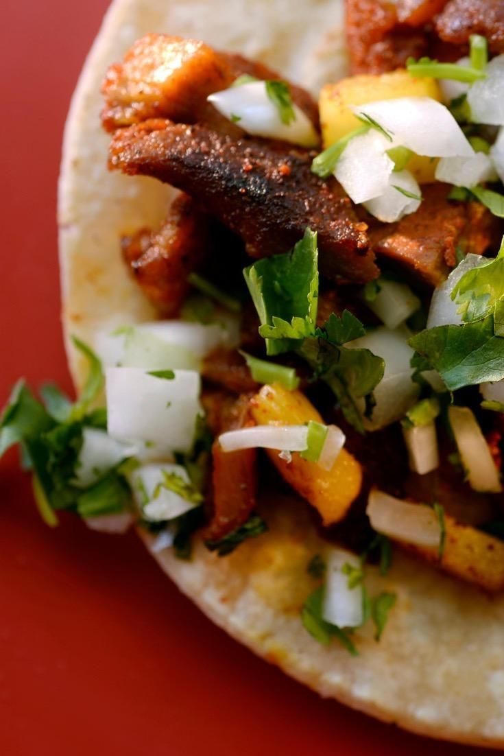 Tacos al pastor: The tacos seen on nearly every Mexican city street corner are the happy marriage of Lebanese shawarma and spice-rubbed grilled pork.