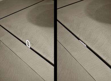 Moab 80  dettaglio della maniglia del sistema di apertura che permette l'ispezione e la pulizia del bacino.