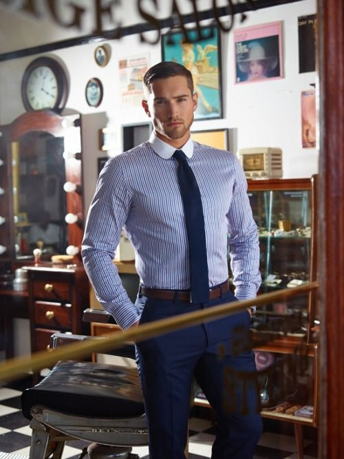 Business outfit - dark blue pants (business suit), dark blue tie, blue shirt with stripes and white collar, braun belt.   See the cities with the most handsome guys >>> checkered shirt