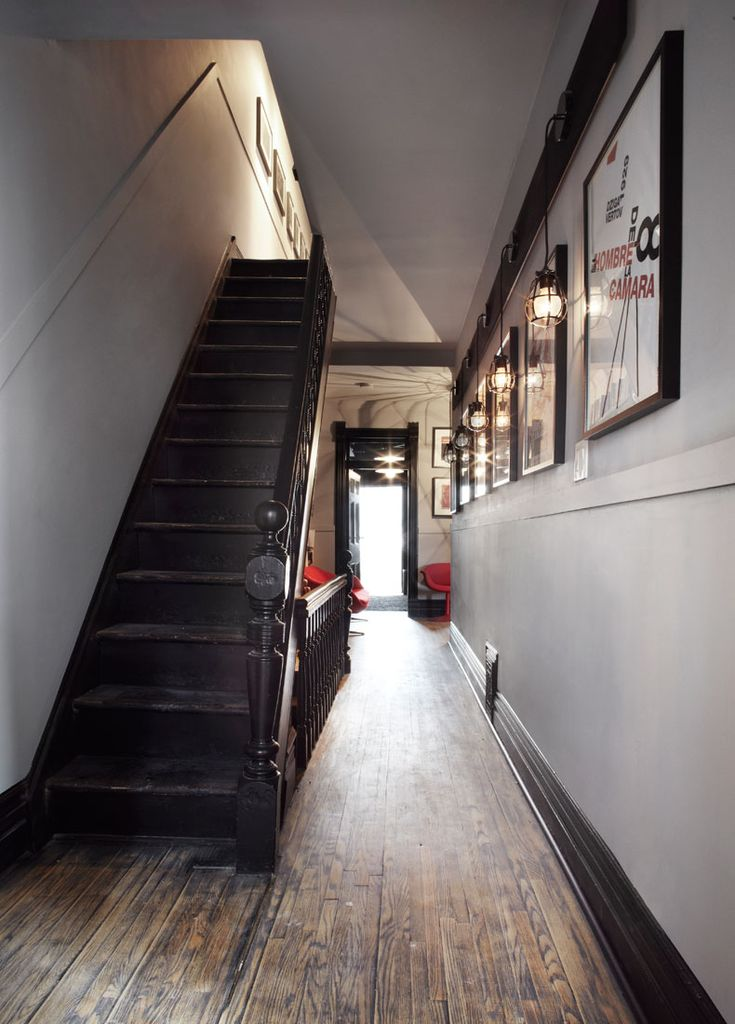 http://stephanechamard.com dark painted woodwork narrow hallway