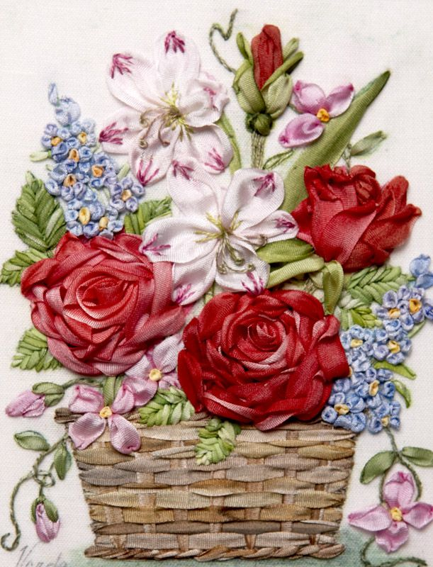 Really want to try some ribbon embroidery - love the use of stitching to give the coloured tips for petals.