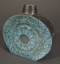 Troika Pottery flask, painted with blue and black foliage and motifs onto a black glazed ground, 17cm high