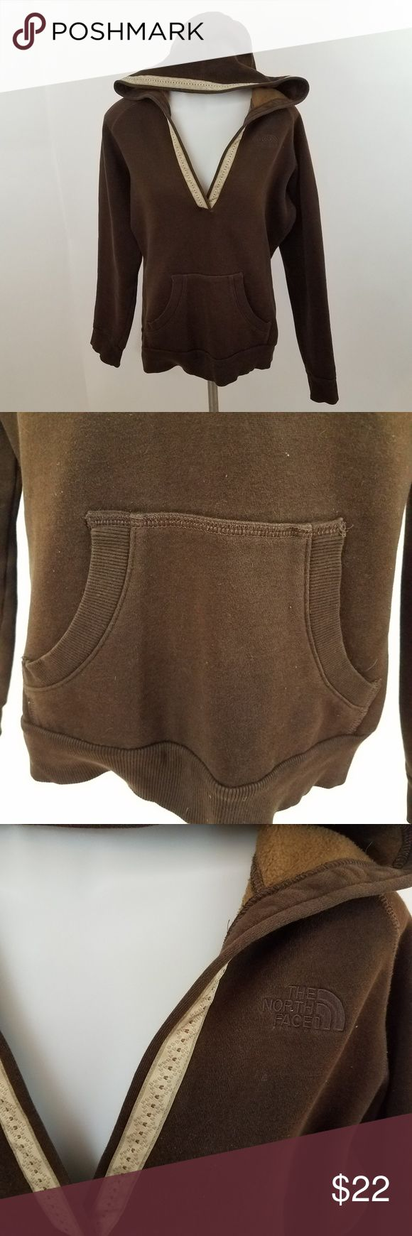 North face hoodie v-neck sweatshirt The north face brown hoodie v-neck womens M sweatshirt  Size m, see measurements below. Used. bleach stains. See photos.  Measurements are taken while item is lying flat.  Length: 26 Inches  Armpit to Armpit: 21 Inches  Inv AM. The North Face Tops Sweatshirts & Hoodies
