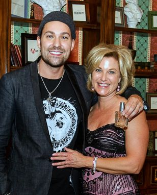 Musician David Garrett celebrating the special custom fragrance created to raise funds for Radys Children's Hospital.