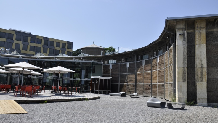 Lokremise St.Gallen repurposed train roundhouse. Now a restaurant, public art gallery, and community event center.