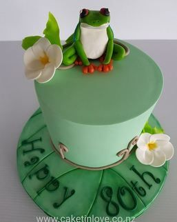 "A 6"" chocolate cake filled with chocolate ganache, chocit frog and fragipanis.  #frogcake   #chocit   #pettinice   #birthdaycakes   #cakesnorthland   #cakeswhangarei   #caketinlove"