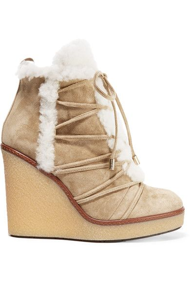 Wedge heel measures approximately 110mm/ 4.5 inches with a 25mm/ 1 inch platform Sand suede, cream shearling Zip fastenings at sides Made in Italy