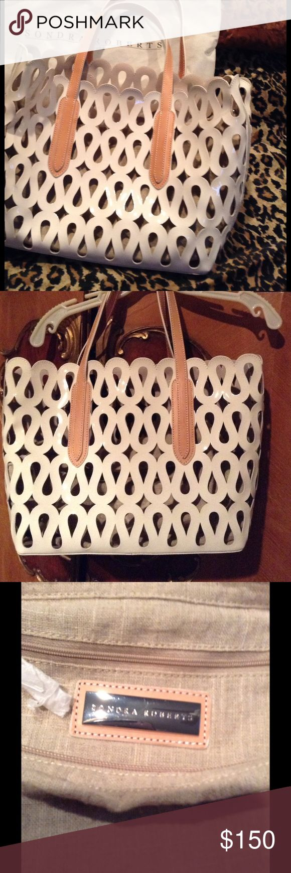 🎉 CLEARANCE 🎉 Sondra Roberts Laser Cut Tote A cut above. Enhance any outfit with the addition of this glossy patent leather tote. Laser cut detailing shows off the chic canvas look lining. Laser cut detail around entire purse, inside lining visible with canvas look, zip top closure body of purse is patent leather.  Bottom of purse is gorgeous with for metal feet and brown leather decoration around them.  Purse has beautiful tan leather straps.  Comes with original dust bag. Sondra Roberts…