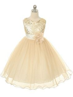 Lovely layers of floating tulle and sheer fabric paired with a twinkling bodice make this dress a perfect and comfortable dress for any Holiday or Special Occasion. This charming little dress also boa