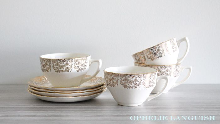 Stunning vintage set of four Georgian China tea cups and saucers in the Briar Rose pattern. Beautiful pink centre rose motif (on saucers) against a cream background. Ornate 22KT gold filigree borders. Scalloped edges. Very elegant and shabby chic.