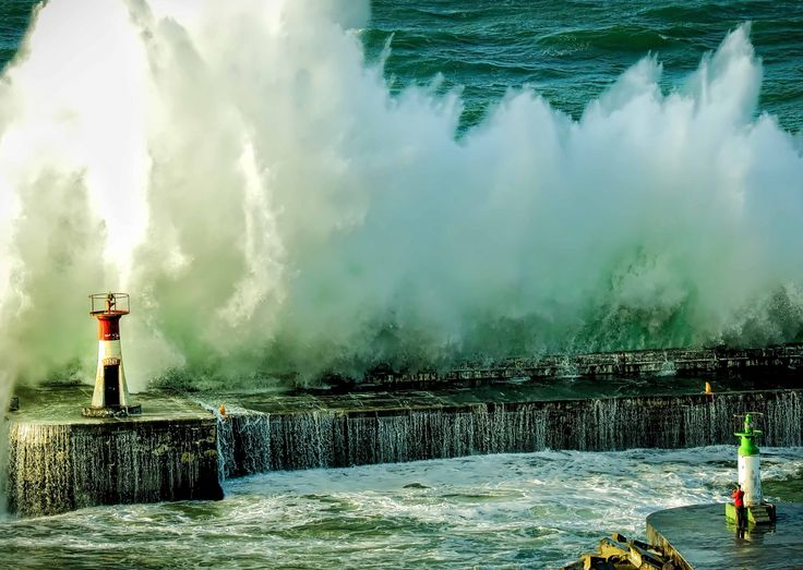 Waves crashing against harbour wall, Kalkbay Cape Town.