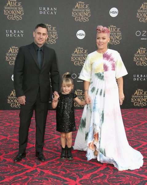 """Pink Photos - (L-R) Motorcycle Racer Carey Hart, Willow Sage Hart and singer-songwriter P!nk attend the premiere of Disney's """"Alice Through The Looking Glass at the El Capitan Theatre on May 23, 2016 in Hollywood, California. - Premiere of Disney's 'Alice Through The Looking Glass' - Arrivals"""
