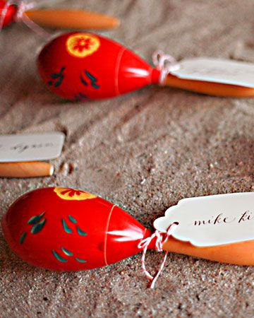 Seat Assignments - For escort cards that will have your guests all shook up, borrow this idea from Nina and Jon's wedding. Have guests' names calligraphed on tags before you leave, and the hotel can help you source local maracas (that will double as favors) so you don't have to bring them along. The instruments can be shaken as a signal that a toast is forthcoming (rather than the typical clinking of glasses) or as a send-off when you make your escape as the night's winding down.