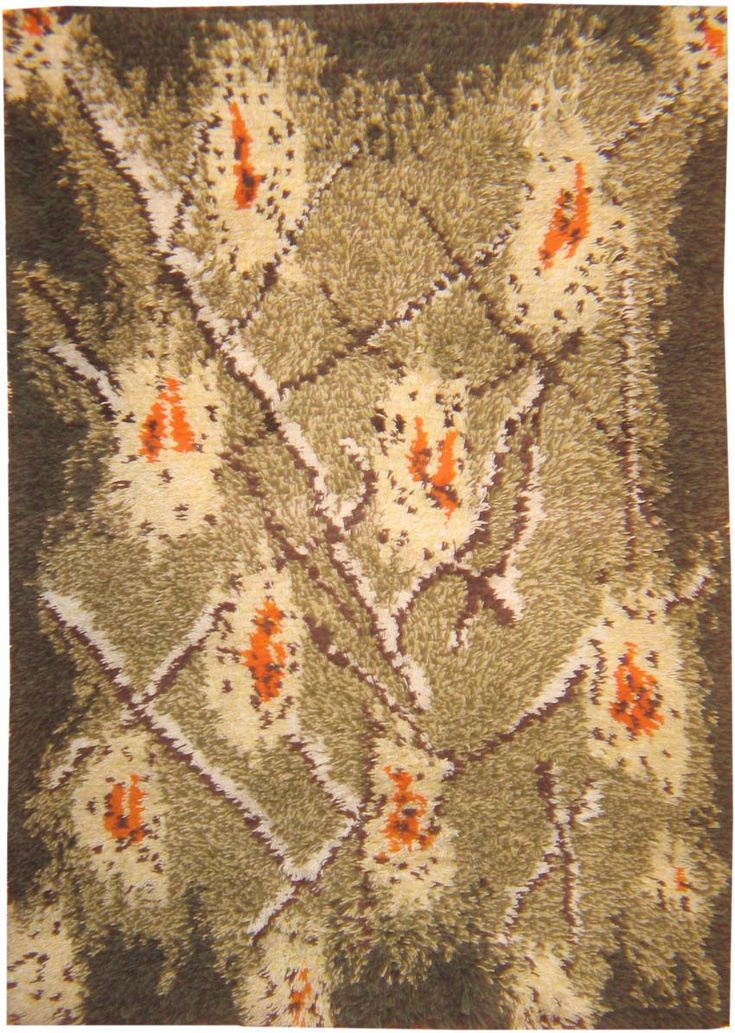 Rya Rug, Finland, circa mid-20th century | This example reflects the modernism that developed in Scandinavia after the Second World War, with its abstract asymmetrical network in brown and white on grey, accented with flashes of color