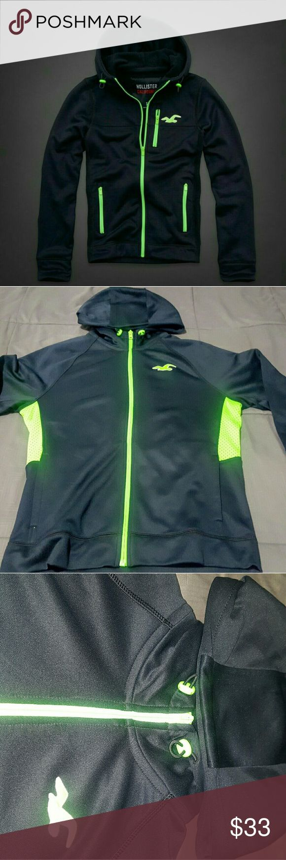 Men's Hollister Full-Zip Sports Hoodie ( L ) New Brand New - From EaZy Ebay & Amazon Sales?  Hollister full zip-up sports polyester hoodie. Dark blue solid color with lime green lining and hollister logo. Fabric 95% Polyester, 5%. Has Headphone pocket on left (inside ) part of the hoodie.  Has thumb holes for comfortable wear.  The only available size is LARGE. Item is in brand new condition.  Very soft fabric and very comfortable and lightweight. Great for any kind of sports or athletic…