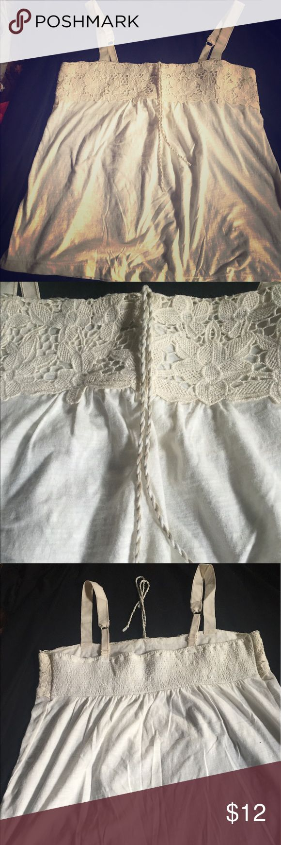 American Eagle Cream Cami w/lace SZ large Cute summer American Eagle cream Cami with adjustable straps. Fabric is cotton, adjustable straps, smoke free home. American Eagle Outfitters Tops Camisoles