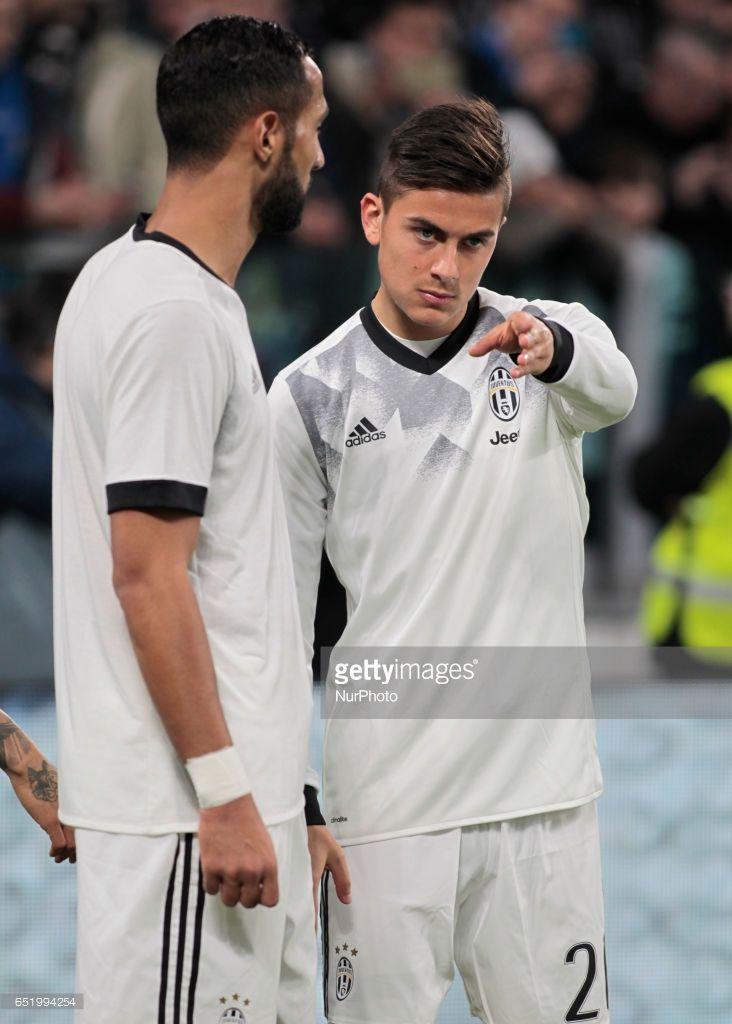 Medhi Benatia and Paulo Dybala during Serie A match between Juventus v Milan, in Turin, on March 10, 2017