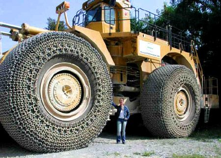 The Caterpillar 994 -   The Cat 994 is a seriously big loader. I'd love to drive one of these bad boys, that would be wild! Look at those chains!!!