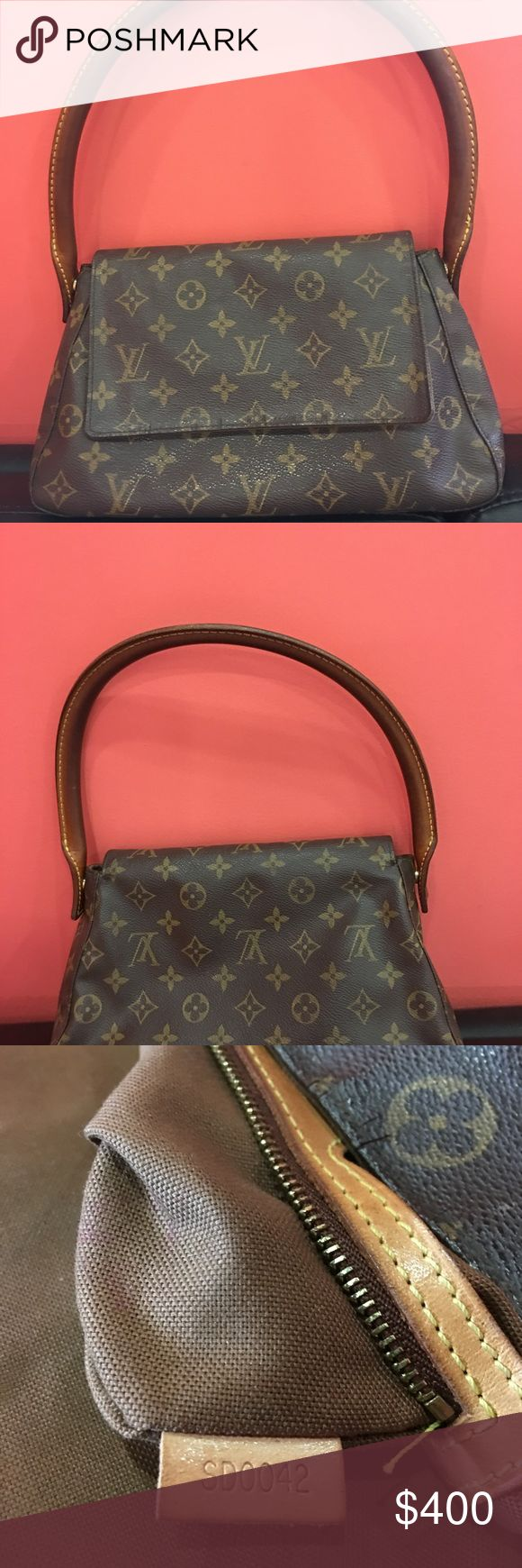 Louis Vuitton small handbag 6.7 inch bag length. Coated canvas magnetic closure. Gently used. Louis Vuitton Bags Mini Bags