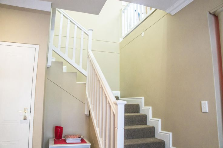 Stairs leading to the second floor of this double storey property.