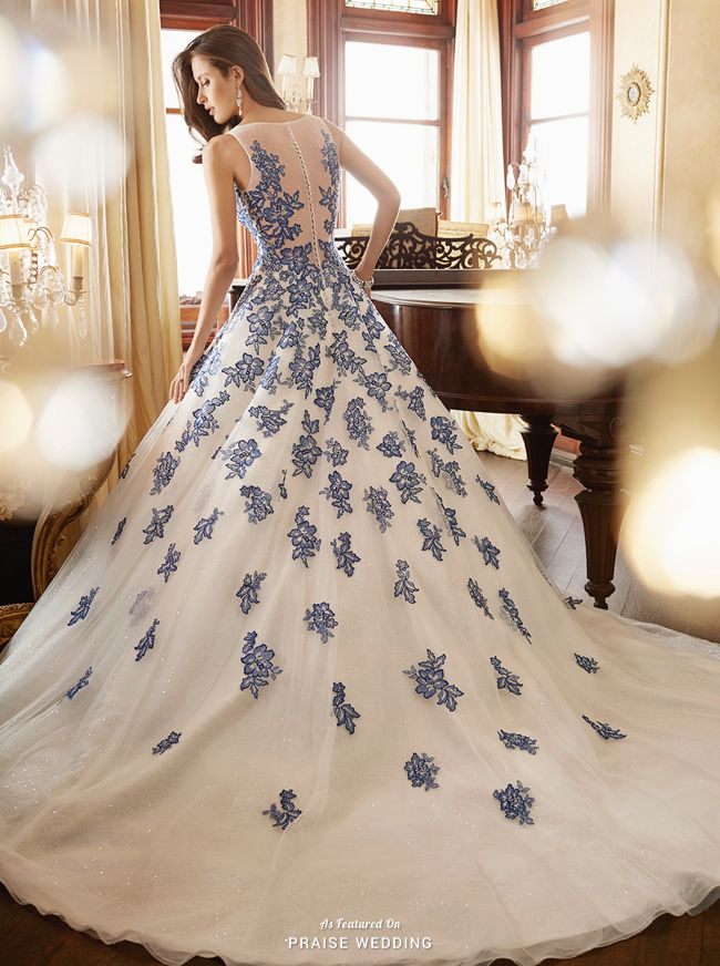 This stunning gown from Sophia Tolli featuring royal blue embroideries and metallic glittering details is jaw-droppingly beautiful!