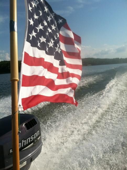 Old Glory flying behind a boat. Favorite.