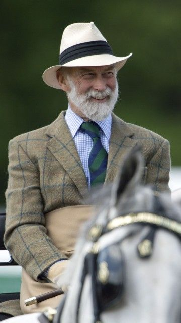 Prince Michael of Kent seemed to really enjoy riding in his carriage.
