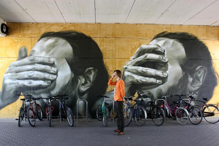 Bike parking near Banksy's Graffity in Galicia art