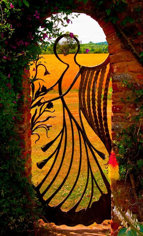 20 Beautiful Garden Gate Ideas.  Some of these are breathtaking...like this angel!