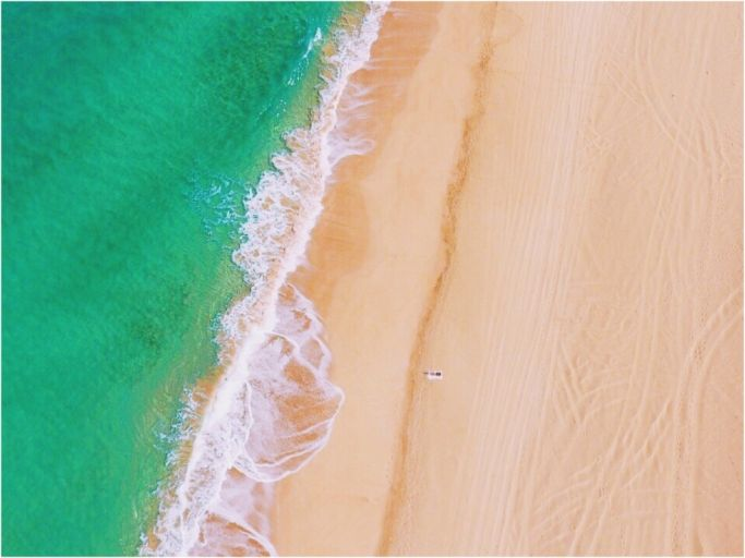 The only one on this white sand beach. Kauai Hawaii - Drone Photography