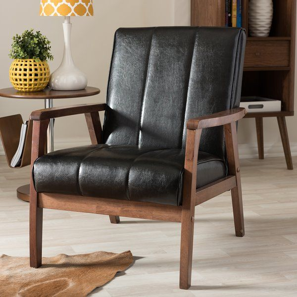 A timeless twist on mid-century style, the Kinley Lounge Chair is a coveted addition to any living space.