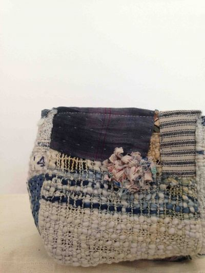 Kate Whitehead is a textile artist specialising in weave and embroidery. Kate works with poor materials such as Calico, muslin, and salvaged fabrics. The work explores the possibilities in the forgotten, overlooked and abandoned.