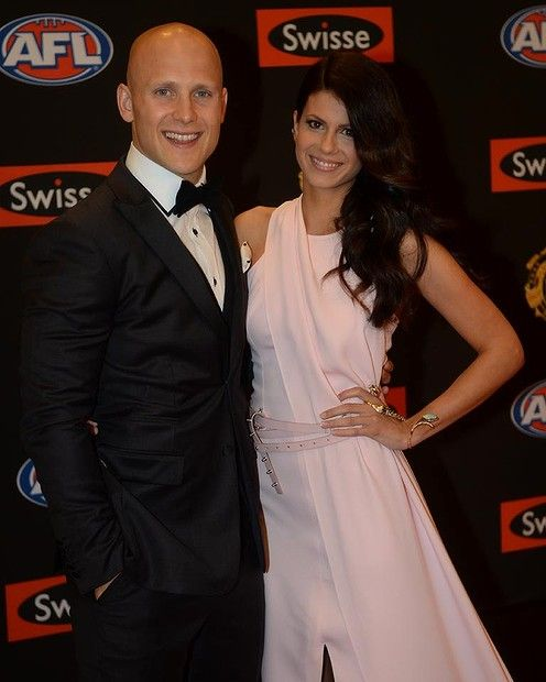 Gary Ablett and Jordan Papalia. bracelet accessory, an eye-catching bling-y ear cuff and a sapphire, opal and white diamond ring-and-bracelet piece that snaked across her wrist.   AFL Brownlow 2013