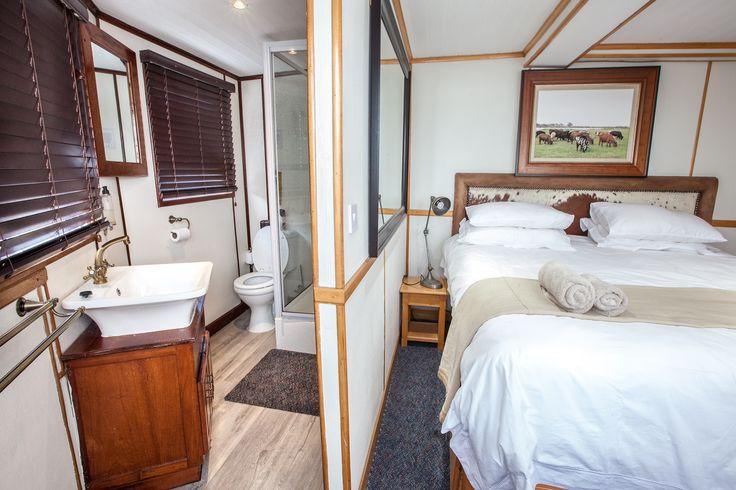 The Pangolin Voyager Houseboat en suite cabin.