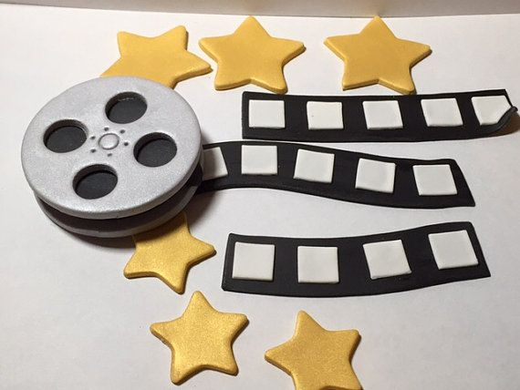 Edible Cake Decorations  Includes: -Film reel 2 1/2 -3 Film strips 3 1/2 - 4 -6 Gold Stars (If you would like a color other than gold please let