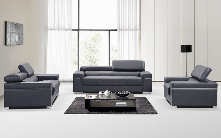 Contemporary grey Italian leather sofa set with adjustable headrest. Reinterpreting what a living space should look like with a seal of quality, the Italian designer leather sofa set in grey reflects sophisticated elegance and eccentricities of 21 century modern design. Its masterful craftsmanship i...