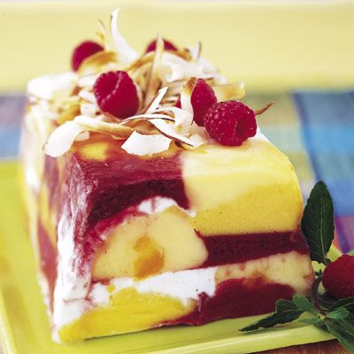 This artful sorbet dessert couldn't be easier to make: Simply scoop and press alternating layers of raspberry, mango, coconut, and orange sorbet into a loaf pan and garnish with coconut and fresh berries. Recipe: Tropical Sorbet Loaf   - Delish.com