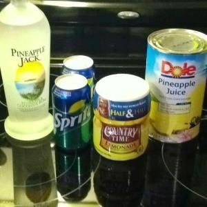 PINAPPLE RUM PUNCH 1 can pineapple juice (46 oz), 1 cup Country Time lemonade mix, 2 cups water,  2 cans Sprite,  and one bottle of Pineapple Coconut Rum. by mildred