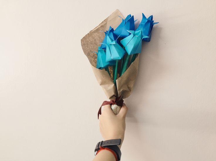 Simple and minimalist blue origami tulips