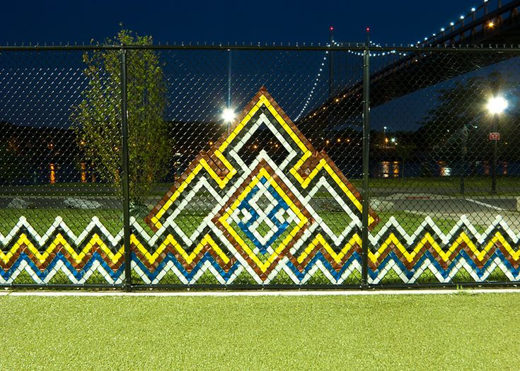 Plastic ribbon woven into chain link fence    2011