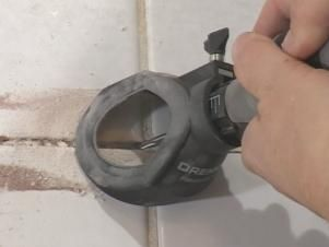 Host Amy Matthews shows how to easily remove grout around a bathtub and replace it with new grout.