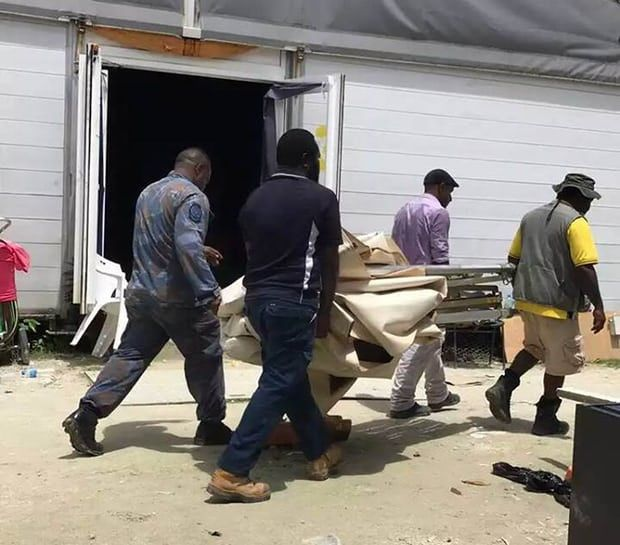 Papua New Guinean officials and police take away makeshift shelters built by refugees and asylum seekers on Manus Island.