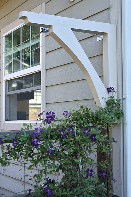 A well hidden clothesline on back of house! from Homestead Revival blog. Smart idea instead of tacky poles in yard